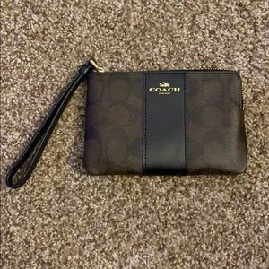 Coach Wristlet. Black and Brown Leather.